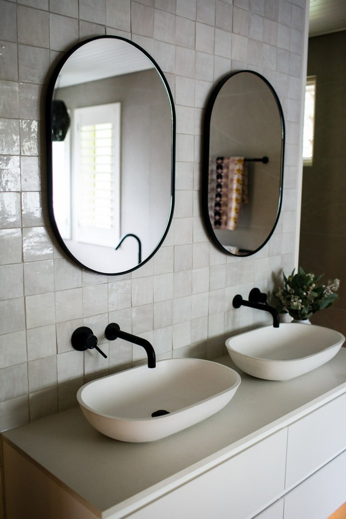 Bjorn Oval Mirrors over twin vanity