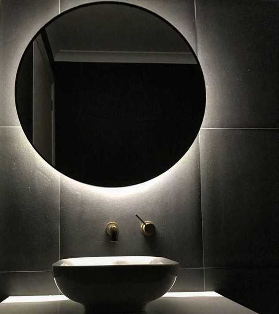 Backlit mirror over vanity