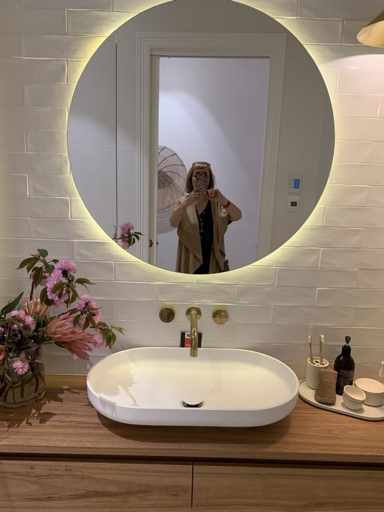 Frameless Mirror with LEDs. Mirror is made to fit LEDs but LEDs not provided.