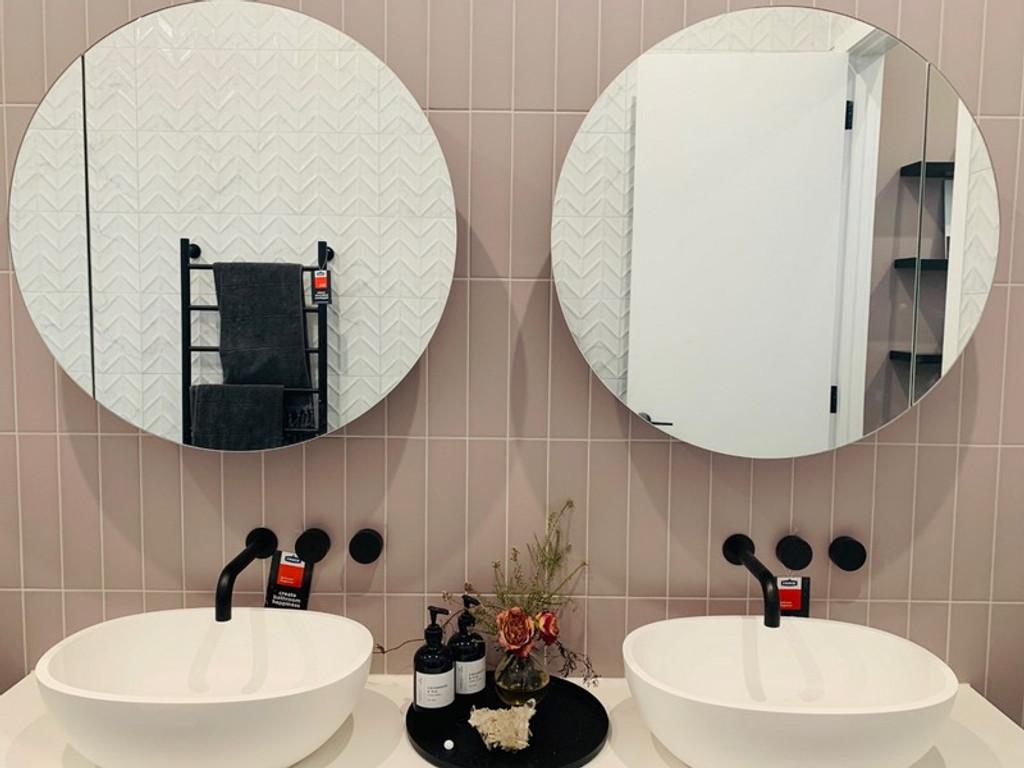 Frameless Round Mirrors over vanity