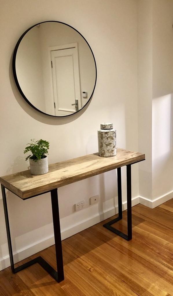 Modern Circular Mirror, above a side table