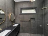 Modern Round Brass Mirror, in  a bathroom