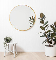Modern Round Brass Mirror, in a room