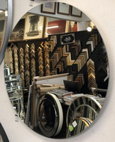 Frameless Round Mirror hanging out with friends in our shop