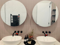 Frameless Round Mirrors over vanity