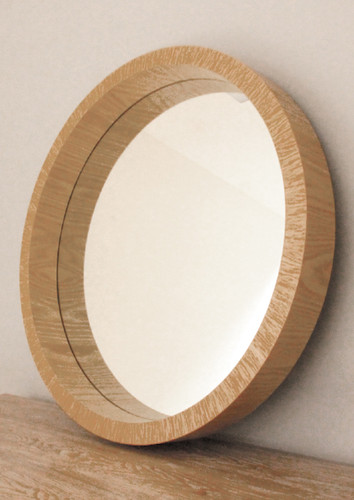 Beautiful, elegant round mirror with a stand out wooden frame. It is around 81 cm in diameter.