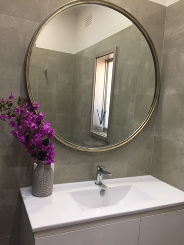 Simplicity Mirror in Silver in a room