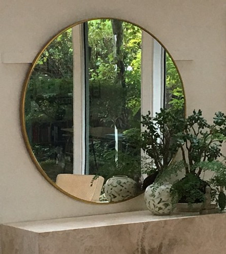 Modern Round Brass Mirror, in situ