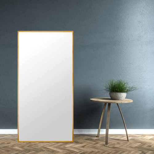 Stella Brass Leaner Mirror in a room