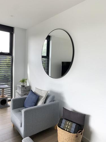 Modern Round Mirror | Bjorn | In a livingroom