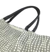 Rolled leather handles of the Strands Jacquard Charcoal Lola Tote Handbag by Filippa Piuggi