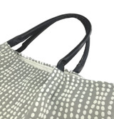 Rolled leather handles of the Strands Jacquard Charcoal Lola Tote Handbag by Filippa Piuggi