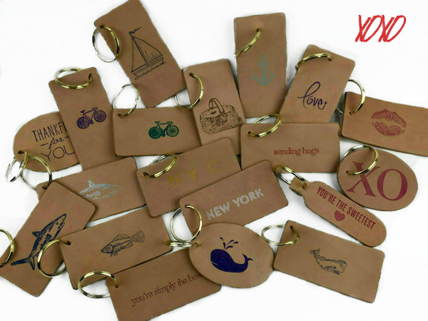 Express your creativity fully with the whimsical modern style of customized leather keychains. With hand-stamped artwork or quotes in many different styles, each piece is unique. Choose your favorite one. These make the perfect gift.  Express your creativity fully with the whimsical modern style of customized leather keychains. With hand-stamped artwork or quotes in many different styles, each piece is unique. Choose your favorite one. These make the perfect gift.