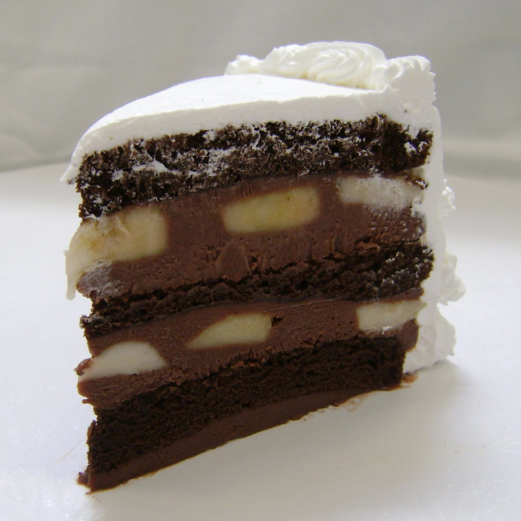 BANANA CHOCOLATE: moist layers of Chocolate cake layers filled with creamy Chocolate custard layered with fresh sliced bananas. (Please note: bananas may turn dark as they naturally ripen.) Add $3.