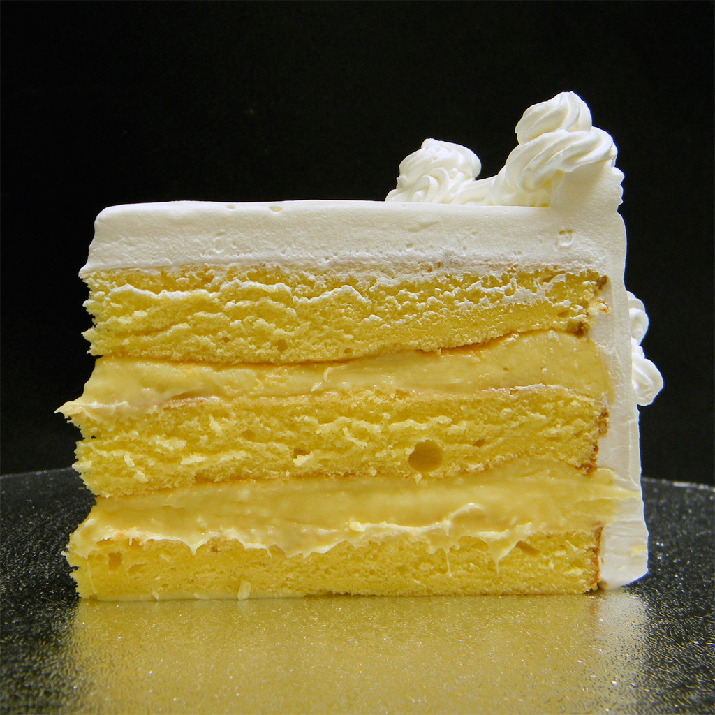 FRENCH VANILLA: moist layers of Yellow cake filled with creamy French Vanilla custard. AMARETTO: moist layers of Yellow cake filled with non-alcoholic Amaretto custard. LIMONCELLO: moist layers of Yellow cake filled with zesty Lemon custard.