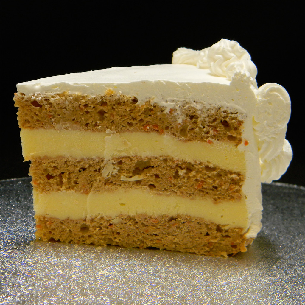 CARROT: our moistest cake and not your traditional carrot cake. More like a spice cake baked with carrot flakes and the necessary spices, filled with French Vanilla custard. No nuts or raisins.