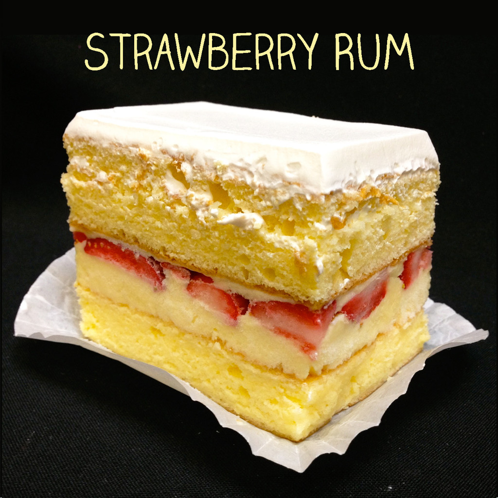 TOP SELLER ALERT: this flavor has been our best seller for over 39 years! Two layers of moist Yellow cake filled with our (non-alcoholic) Rum custard, layered with fresh strawberry slices, and topped with Lisa's Italian whipped cream.