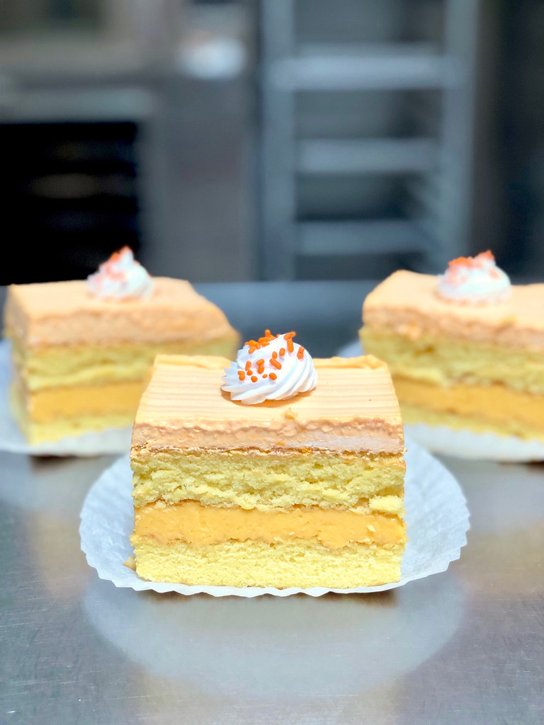 Sicilian Orangesicle: yellow cake filled with creamy natural flavored Orange custard, frosted with Lisa's signature Italian whipped cream.