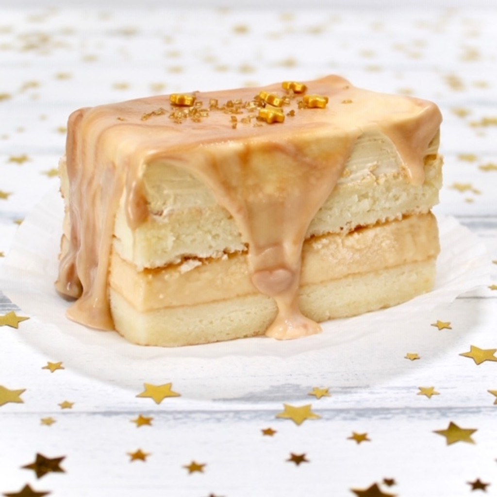 Butter-beer:  yellow cake filled with Butterscotch-Rum custard frosted with Lisa's signature Italian whipped cream enrobed in white chocolate/butterscotch ganache.