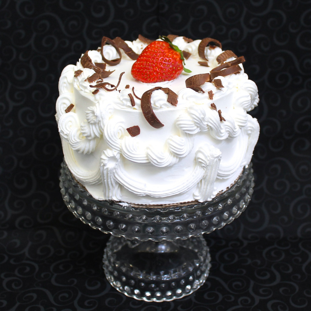 Choose from four original Cathy's Rum Cake® flavors and we'll decorate it with fresh strawberries and shaved chocolate!