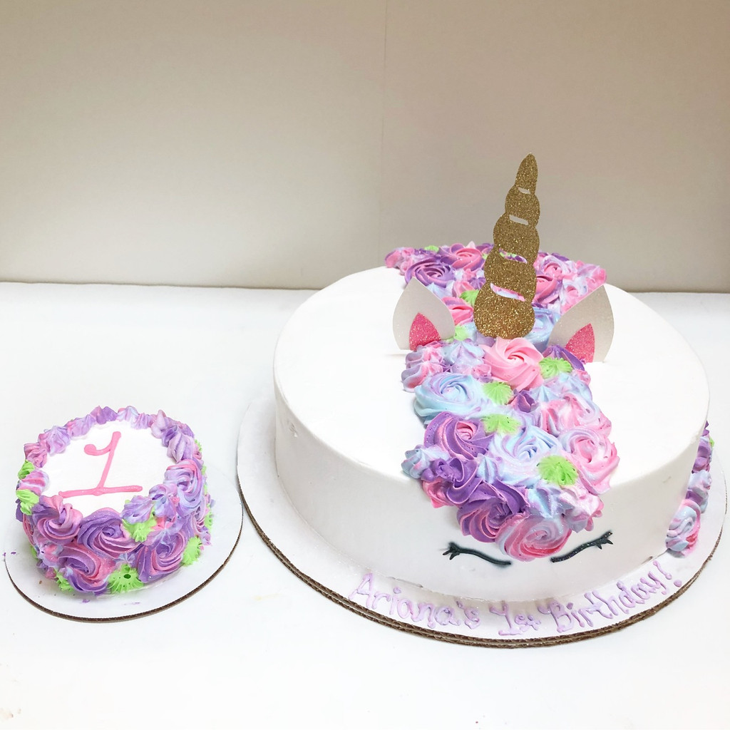 *CUSTOM ORDER* Call for special topper set featuring pink ears and gold horn. You can add a matching smash cake from $15+.