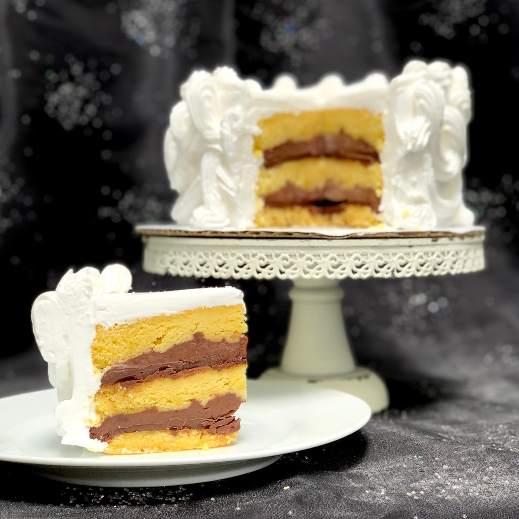 Round and square cakes have three layers of cake with two layer of custard and Nutella filling, as shown. Sheet cakes have two layers of cake and one layer of custard and Nutella.