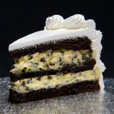 TUXEDO: moist layers of Chocolate cake filled with creamy French Vanilla custard studded with mini, gourmet, dark chocolate chips.
