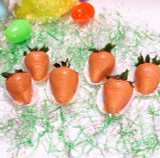 Premium strawberries dipped in orange colored white chocolate ganache with edible glitter.