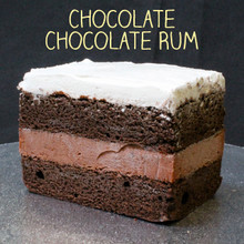 44+ year classic: two layers of moist Chocolate cake filled with signature Chocolate (non-alcoholic) Rum custard and topped with Lisa's Italian whipped cream.
