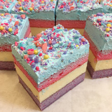 Unicorn: whimsical cake layers filled with creamy French Vanilla custard, frosted with Lisa's signature Italian whipped cream and custom cotton candy sprinkle blend.