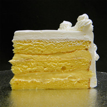 Original Rum: three moist layers of Yellow cake filled with signature Italian (non-alcoholic) Rum custard, frosted in Italian whipped cream.