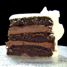 Chocolate Chocolate Rum: three moist layers of Chocolate cake filled with signature Italian (non-alcoholic) Chocolate Rum custard, frosted in Italian whipped cream.