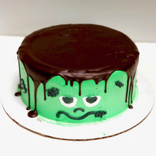 Dark chocolate ganache and green tinted whipped cream frosting.