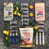 1X Whittakers 250g berry and biscuit block  1X Whittakers 250g Dairy Milk block  1X Whittakers 180g 12 pack Mini slab bag  12X Peanut Slab 15g Mini Slab   3X Whittakers 25g Sante white Chocolate   3X Whittakers 25g Sante white Chocolate dairy milk