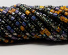 6/0 Aged Imperial Purple Tube Picasso Mix (1/4 Kilo)