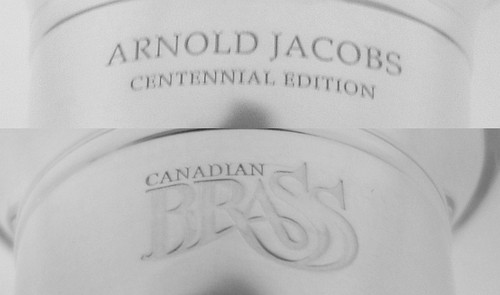 "This beautiful Arnold Jacobs Centennial Tuba  Mouthpiece comes in both Gold and Silver Plate finishes with ""Arnold Jacobs Centennial Edition"" on one side and the Canadian Brass logo on the other."