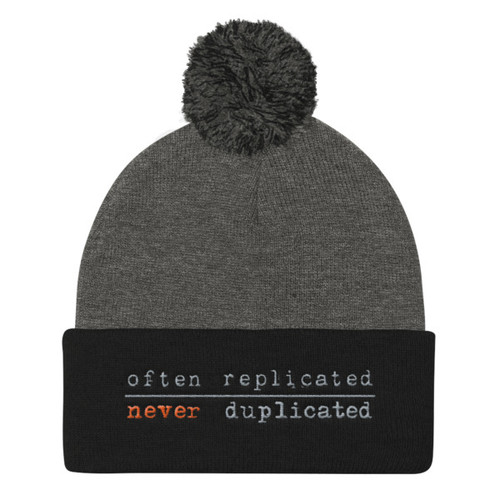 Often Replicated Never Duplicated II Pom Pom Knit Cap