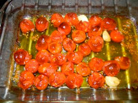 Red Cherry tomatoes make a delicious roasted tomato sauce. Wash the tomatoes, peel a few cloves of garlic, and mix with a few tablespoons of olive oil. Sprinkle with salt and roast at 400 degrees for 20 minutes. Stir, then return to the oven for another 20 minutes. The tomatoes will collapse, brown a bit and the juice will start to carmelize. Serve over pasta as is, or blend half the tomatoes and thicken with pasta water, then add pasta to the pan and stir to coat.