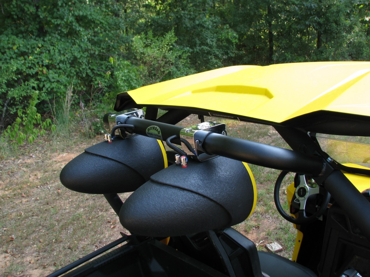 Can Am Commander (shown with custom painted Tsunami Waketower Marine Speakers)