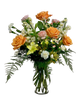 She's a Peach:  Arrangement of orange roses, peach carnations, yellow lilies, and cream stock, in a keepsake clear glass vase
