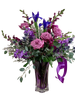 Regal Amethyst:  arrangement of purple snapdragons, irises and roses in a purple swirl crystal vase
