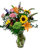 Consider Me Spellbound:  garden-style arrangement of colorful flowers in an 11-inch clear glass Ming vase