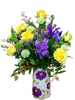 Spring Garden Pitcher:  arrangement of yellow roses, purple stock, blue iris, and green miniature carnations, in a keepsake ceramic pitcher with a modern floral motif