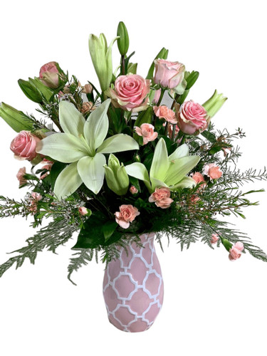 Delicate Kiss:  arrangement of pink roses and white lilies in a pink and white ceramic vase