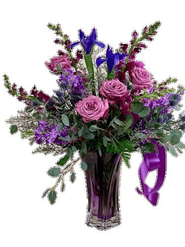 Regal Amethyst:  arrangement of purple snapdragons, irises and roses in a purple swirl crystal vase