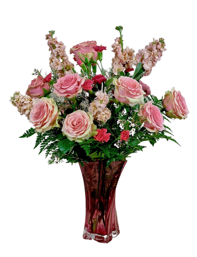 Always My Sweetheart:  arrangement of pink roses, pink stock, light and hot pink carnations, and seasonal greens, in a keepsake vase of pink crystal