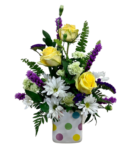 Connect the Dots:  arrangement of purple liatris, yellow roses, white daisies and green carnations, in a polka-dot ceramic cube
