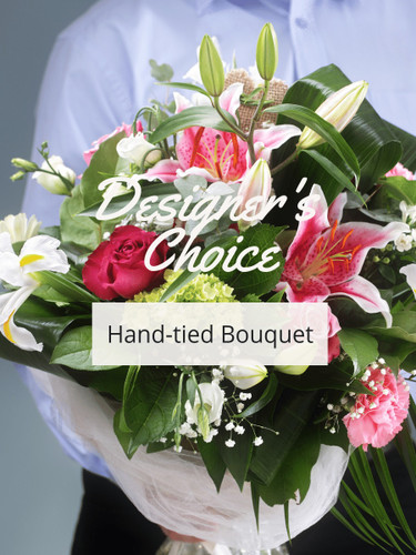 Designer's Choice Hand-Tied Bouquet:  Colorful bouquet of flowers wrapped in paper