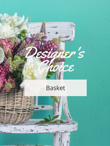 Designer's Choice Basket Arrangement:  Arrangement of colorful flowers in a woven basket