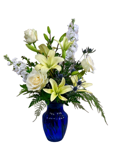 Serene Blue Skies:  arrangement of white flowers in a cobalt blue vase